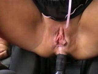 She sits on the gear shift with her pussy
