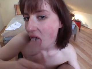Horny brunette German girl is sucking a cock and giving a titjob from his pov