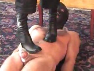 Mistress in high heels walks on him