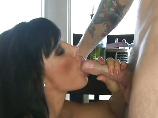 Lisa Ann gets on her knees to mouth a horny cock