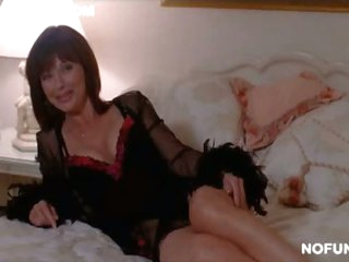 Seductive MILF Celeb Janice Hamilton Laying On a Bed In Hot Lingerie