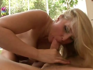 Insatiable Julia Ann wraps her lips around a huge dick