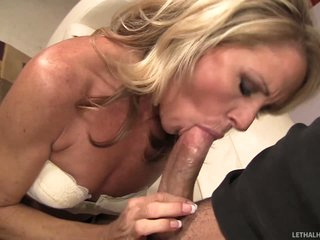 Good looking slim blond MILF Nikki Charm takes sturdy cock in her mouth. But after cock sucking she uses her tongue to give pleasure to her fuck buddy. She licks his asshole and he loves it so much.
