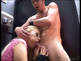 Cailey Taylor sucking a hard cock at the public toilet