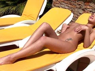 Naked beauty Henessy taking sunbath