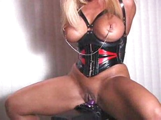 Bound in latex and humping the dildo