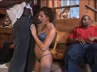 Curly hair girl on her knees sucking black cocks
