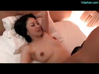 Mature Woman In Black Stockings Getting Fucked By Young Guy On The Bed