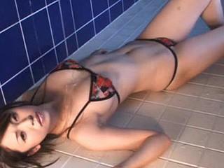 Oriental model Yurina Sato in the beach having a hawt photoshoot in her sexy bikini.