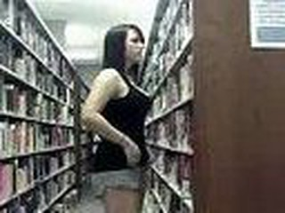 This college girl is in the library, using a computer with a web cam.  She pretends to be studying, but she is really texting her boyfriend, and flashing him.  Outrageous.