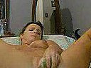 This horny brunete mom set up her webcam to show the world what she needs (dad are you listening????) .  She gives her pussy a good workout with a plastic wrapped cucumber. Legs wide, pussy stuffed.... hard.....aaaah mother's day.