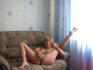 Blonde mature sex addict does a wicked magic trick with her undies. She shoves them deep in her cunt making them disappear. Then with a simple tug, she pulls them back out and voila they're wet!