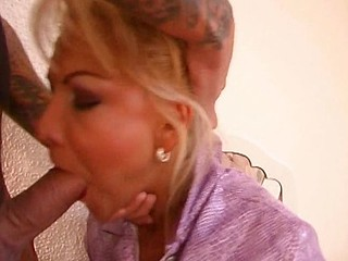 Blonde doesn't seem to like giving head but he insists and pounds her and gives her messy facial