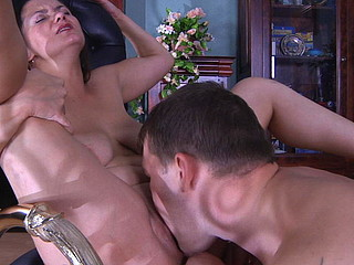 Experienced mommy servicing a muscle stud with her open mouth and her cum-hole