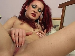 Scarlet red Sarah James strips for the mirror and opens up her legs for a wicked hawt solo session