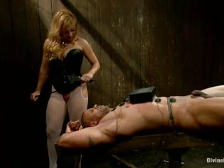 Mistress Lea enjoys playing with electricity and muscled guys. She takes her job very seriously and punishes her guy like a real dominatrix. Her blonde hair, slutty face and those sexy legs under her white pantyhose can make a guy horny, especially when he's all tied up and with electrodes on his body.