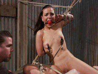 He tied her in a very uncomfortable position and used clamps on her nipples. She is ball gagged so that the screaming and moaning won't disturb the executor as he roughly rubs her cunt with a vibrator. The slut stays there and has nothing to do then accept her situation. Curios what else awaits this bitch?