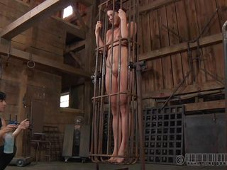 A metal cage and a harsh mistress is all that this cunt needs to be disciplined. Stick around and enjoy how the mistress plays with this naked cutie and how obedient she will become. Every naughty bitch deserves a treatment like this!