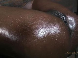 Black, sweaty and with a big hard cock in her ass. This is Ana and her situation is between pleasure and pain. The ebony milf is secured in a wooden bondage device, has her mouth gagged and her tight anus filled by the white executor. He loves seeing that white penis entering her black hole, do you enjoy it too?