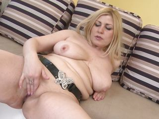 This slutty blonde lady is in her room and touching her body softly to make her feel horny. She is going out of control and watch her squeezing her cherry like hard nipples. She is rubbing her nice shaved pussy to make it wet so that she can insert a big dildo in her pussy and take the heavenly feelings.