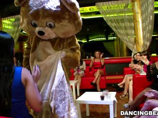 A group of beautiful milfs are in this striptease bar. After a hard day of work or sucking their husband's cocks the milfs are taking a well deserved break and relax. Things start to get hot and heavy when the dancing bear makes his introduction. He has a big hard cock and these sluts want to have a taste of it