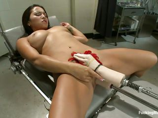 Adrianna Luna is in what looks like a doctor's office, but who cares? What matters is this busty Latina is getting fucked by this machine! A hand with a feather rubs above her clit, a small vibrator in her hand is on her clit, and a dildo is fucking her juicy taco! Then she turns over for some more.