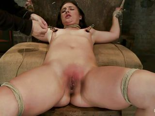 She's tied on her back with her legs spread and has clamps on her nipples, this brunette slut likes to receive a harsh treatment and when the women gives her to suck those nipples she immediately does it, taking a lot of pleasure while doing that. Her pussy is rubbed with a vibrator and her sexy body curls with pleasure, wanna see more?