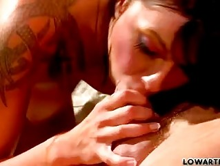 Sluty dark haired babe with tattoo sucks hard knob