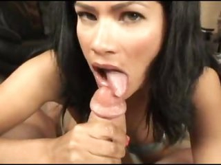 Dark haired Latina cocksucker on her knees
