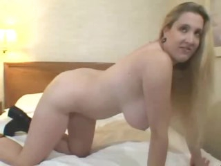 Fat girl in boots toys in hotel room